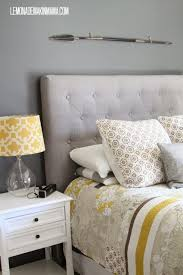 bedroom white matresses brown buttoned fabric based headboard