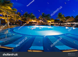 tropical resort swimming pool night stock photo 84887767