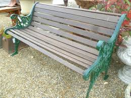 Painting Wrought Iron Patio Furniture by A Wooden And Wrought Iron Park Bench On White Background Stock