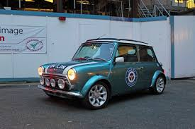 small car small car big city driving a vintage mini through the streets of