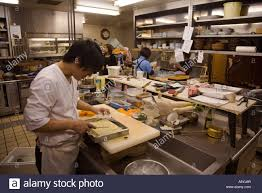 chef with herb butter in japanese restaurant kitchen stock photo