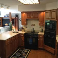 furniture cozy granite countertop with kraftmaid kitchen cabinets