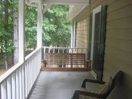 exterior paint wood siding with white porch railing and oak porch