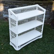 a vintage white wicker bookcase ebth