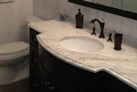 adorable natural bathroom design featuring bath vanity with black