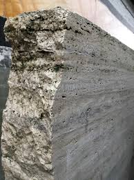 a huge block of silver travertine about to be carved into a