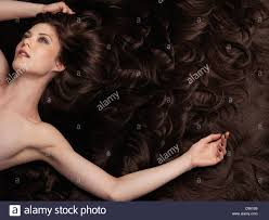 large hair beautiful woman with brown hair and hair extensions