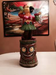 parrot on tiki base statue from the tree shop