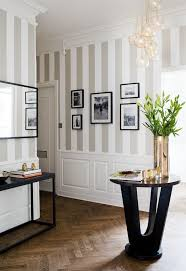 24 bold ideas for striped walls brit co half striped painting stripes only halfway down a wall helps to not overwhelm the space don t the light gray stripes look incredible with the strong black