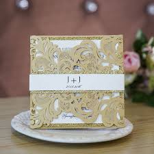 wedding invitations glitter pale gold laser cut wedding invitations with glittery bottom cards