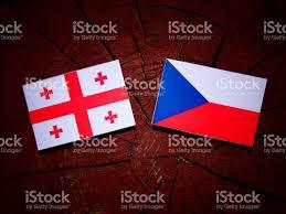 Georgian Flag Georgian Flag With Czech Flag On A Tree Stump Isolated Stock Photo