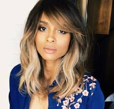a side part with long hair and a swoop and a cross 50 gorgeous side swept bangs hairstyles for every face shape