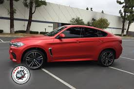 red bmw 2016 bmw x6 m wrapped in satin red wrap bullys