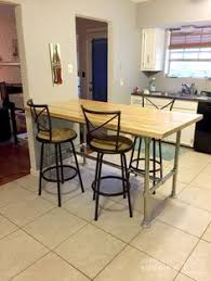 Build Your Own Kitchen Table by Diy Reclaimed Bowling Alley Table Built With Pipe U0026 Fittings