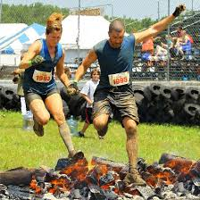 Rugged Manaic Couple Jumping Over Fire At The Rugged Maniac In Englishtown Nj