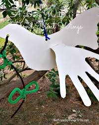 a dove craft using child hand prints as wings peace u0026 love
