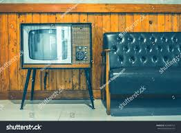 retro tv turned against wood wall stock photo 429456712