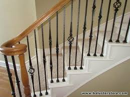 Iron Banisters Decorative Spindles This Iron Staircase Has Decorative Brown Stair