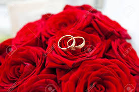 red rose rings images Wedding rings on red roses wedding bouquet stock photo picture jpg