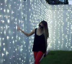 strings of white lights on a white fence just beautiful in the