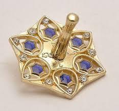 metal dreidel gold plated metal dreidel with blue clear gemstone springnahal