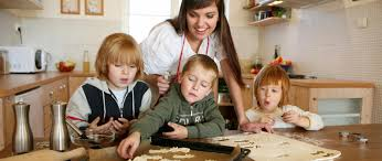 young family making cookies in kitchen u2013 seasons medical