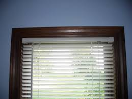 interior design wooden window with horizontal white bali blinds