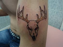 tribal deer skull on left bicep