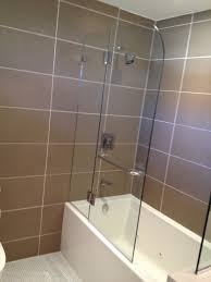 tub with glass shower door undefined