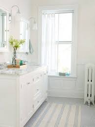 white bathroom vanity with marble tops and double recessed