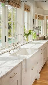 Farmers Sink Pictures by Marble Countertops And White Kitchen Cabinets Kitchen Designs