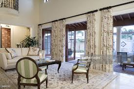 High Ceiling Curtains by Floral Rug And Curtains In White Living Room With High Ceiling