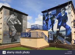 street scene with murals painted on side of a house as part of stock photo street scene with murals painted on side of a house as part of people s gallery by bogside artists in derry co londonderry northern ireland uk