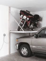 motorcycle storage and riding accessory storage including wall