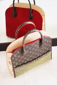 what u0027s in my handbag louis vuitton x christian louboutin posh