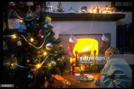 boy next to christmas tree staring at f pictures getty images