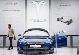 electric vehicles tesla tesla to recall 7 000 adapters after complaints of overheating