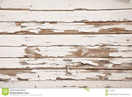 old wood wall with cracked white paint royalty free stock