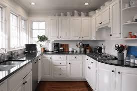 Area Above Kitchen Cabinets Actually Attractive Ways To Style That Awkward Space Above Kitchen