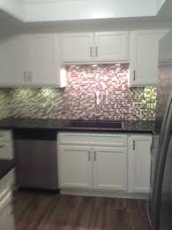 white cabinets with black countertops and appliances blue white kitchen with black granite countertop and
