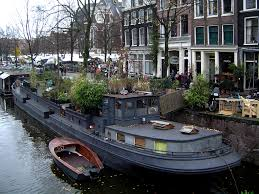 houseboat dutch barge with lots of foliage makes the battleship