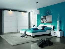 plain teal wallpaint glossy dark gray flooring simple white drawer