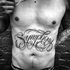 collection of 25 showing chest and stomach tattoos