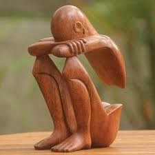 novica brown thought and meditation wood sculpture