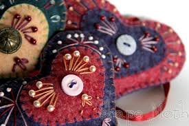 shape moth embroidered ornaments and quilted table runner