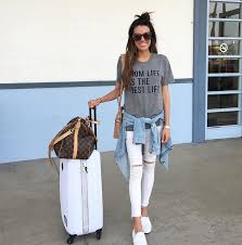 travel outfits images Insta round up comfy summer travel outfits and white distressed png