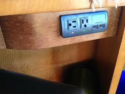 outlets usb and power on desk and on headboard picture of the