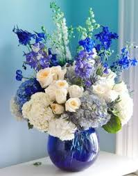 white and blue floral arrangements i really like how this vase adds more to this white and blue