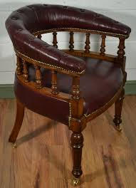victorian oak captains chair with antique burgundy leather