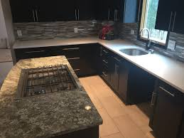 Tile Under Kitchen Cabinets We Installed Ebony Kitchen Cabinets With Glass Mosaic Tile
